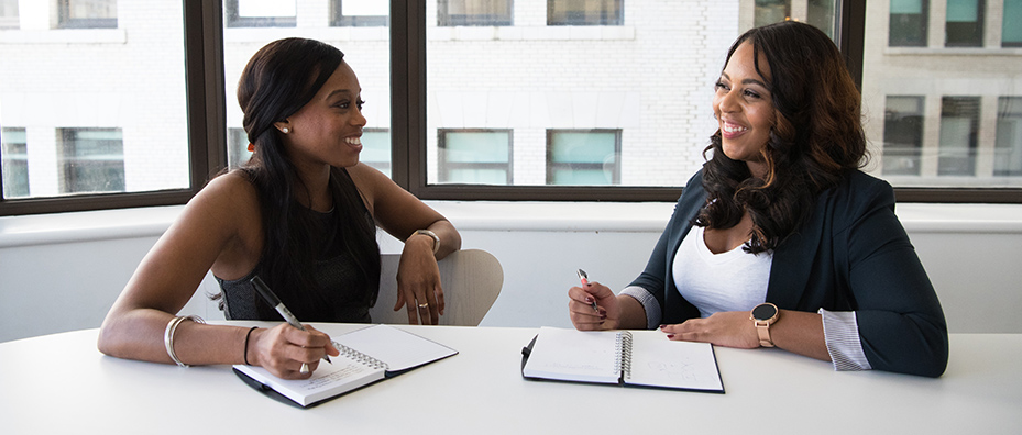 Two women working together in an office